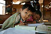 School children writing Bagan, Myanmar