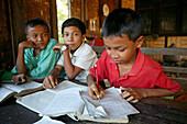 School children busy learning, Schulklasse, Dorfschule