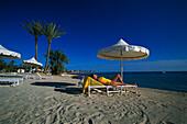 Woman on beach, La Douce, Djerba, Tunesia