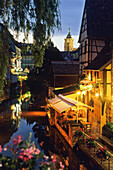 Restaurant in Quartier de la Krutenau at dusk, Old Town, Colmar, Alsace Haut-Rhin, France
