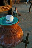 Drinking water in terracotta pot, Wasser aus dem Tontopf, Wasserbehaelter stehen ueberall in Burma traditional water urn, drinking water in terracotta vessel