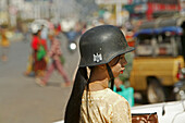 Burmese woman with German military helmet, Myanmar