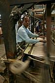 Hand woven silk work on loom, Weberei, Stickerei, Handarbeit, Mann arbeitet am Webstuhl, Silk weaving, Mandalay
