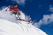 Freeskiing, skier on snowy mountainside in the sunlight