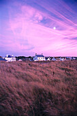 Houses at Cobo Bay at sunset, Guernsey, Channel Islands, Great Britain, Europe