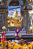 Golden figure and Erawan shrine, Bangkok, Thailand, Asia