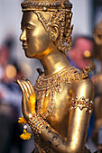 Side view of a golden statue at the temple Grand Palace, Bangkok, Thailand
