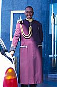 Smiling doorman in front of the Hotel Burj Al Arab, Dubai, V.A.E., United Arab Emirates, Middle East, Asia