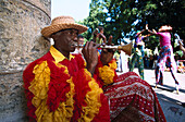 Street musician in the carneval costume playing wind instrument, Havanna, Cuba, Greater Antilles, Antilles, Carribean, Central America, North America, America