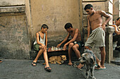 Cuba young boys playing chess on street corner, Cuba