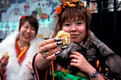 Girls in kimono on Girls Day, with a snack, Asakusa-Tokyo City Japan