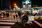Street junction and pedestrian crossing at night, Shinjuku Tokyo, Japan