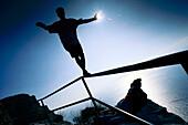 Teenager balancing on a balustrade, Calanque, France
