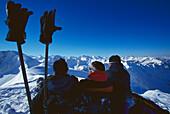 Three men resting on mount Nebelhorn, Allgaeu Alps, Bavaria, Germany