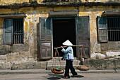 Woman is carrying baskets in Da Nang, Vietnam