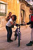 Children near Church Sao Miguel, Alfama, Lisbon Portugal