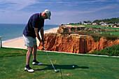 Man hitting golf ball, Vale do Lobo Algarve, Portugal