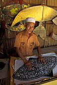 Senior Man building a kite, Kota Bharu, Malaysia, Asia