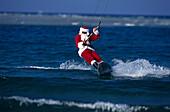 Weihnachtsmann beim Kitesurfen, X-mas Bay of El Naba Rotes Meer, Ägypten
