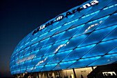 Colorful lit Allianz Arena football stadium at night, Munich, Bavaria, Germany
