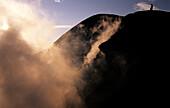 Volcano- person on rim, Tavuvur, Rabaul, East New Britain Papua New Guinea, Melanesia