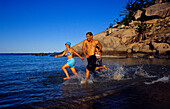 People running on the beach, Magnetic Island, Townsville Queensland, Australia
