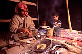 Bedouin family preparing food, Rum Village, Wadi Rum, Jordan, Middle East