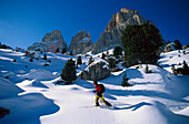Young man snowshoeing, Sella-Ronda, Dolomites, Italy