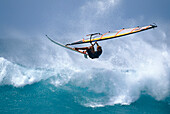 A man with sailboard during a jump, Hawaii, USA, America