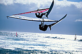 Sailboarders during a jump, Hookipa, Maui, Hawaii, USA, America