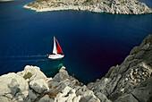 Sailing boat off a steep coast, Turkish Aegean, Turkey, Europe