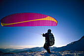 Paraglider preparing for start, Sella- Ronda, Dolomites, Italy
