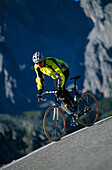 Racing-cyclist on a downhill stretch, Cortina d' Ampezzo, Dolomites, Italy