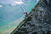 A man with mountain bike freeriding, Arosa, Grisons, Switzerland, Europe