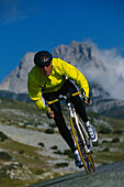 Racing cyclist on a downhill stretch, Campo Imperatore, Abruzzo, Italy