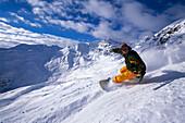 Snowboarder going downhill, Serfaus, Tyrol, Austria