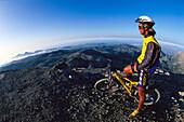 Mountain biker admiring the view, MTB tour, Skinakas, Crete, Greece
