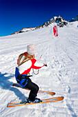 Young woman starting kiteboard in snow, Lermoos, Lechtaler Alpen, Tyrol, Austria