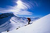 Skier going downhill in the mountains, Vorarlberg, Austria, Europe