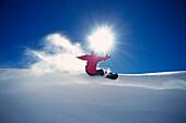 Snowboarder on slope, Arlberg, Vorarlberg, Austria