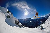 Snowboarder jumping, Arlberg, Vorarlberg, Austria