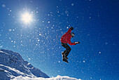 Snowboarder during a jump in front of a blue sky, Valuga, St. Anton, Tyrol, Austria