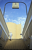 A person going upstairs at a Pedestrian Underpass, Dubai, United Arab Emirates