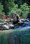 Man roping over a river, Lofer, Tyrol, Austria, Europe