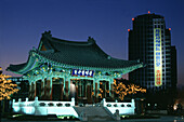 Bell pavilion and highrise at night, Daegu, South Korea, Asia