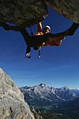 Alpine climber Alex Huber, free climbing, Dolomites, Italy