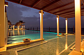 The illuminated Chedi Pool at night, The Chedi Hotel, Muscat, Oman, Middle East, Asia