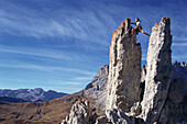 Free climber on rock pinnacle, Dolomites, Italy