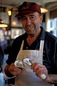 Man opening an oyster, Union Oyster House, Boston, Massachusetts USA, America