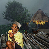 Ifugao women and hut, Banaue, Luzon Island Philippines